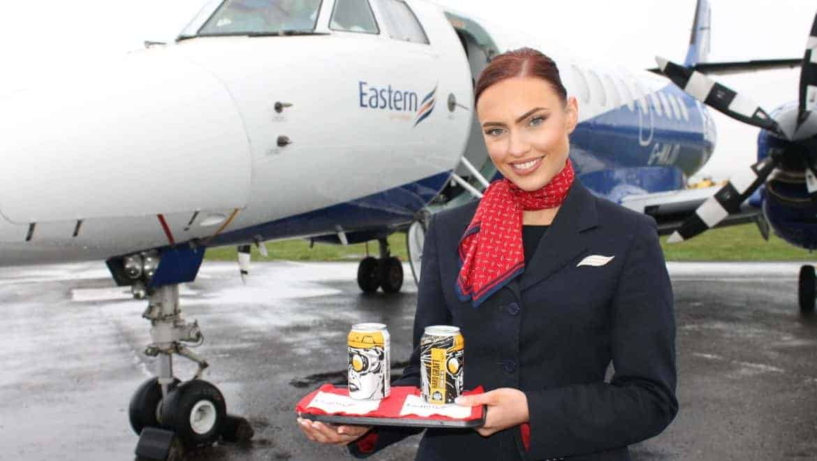 Air hostess holding tray of Docks Beers